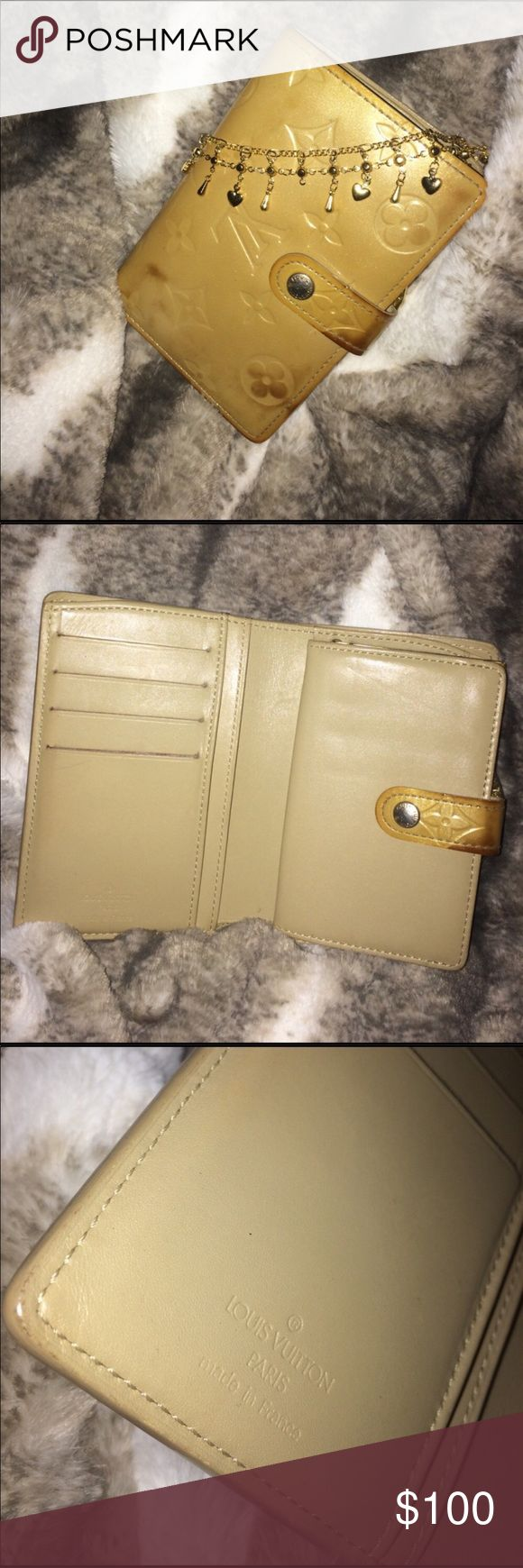 Authentic Louis Vuitton Vernis Kisslock Wallet Re-Posh! This is a goldfish beige patent monogram wallet with 4 card slots, a money insert and a change purse on the back. Carried it once with my bag but the color is off. Date code is there but hard to see on picture. Outside is stained a bit but the inside is impeccable. Taking this as a loss for your gain. Louis Vuitton Bags Wallets