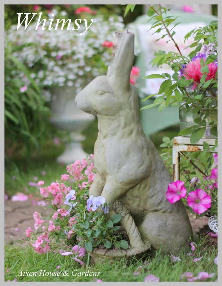 Sweet Cottage Garden Rabbit...with a basket of blooms.