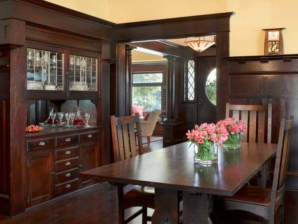 dining room, with its Stickley-style table and chairs, features an original built-in buffet with leaded-glass cabinet doors