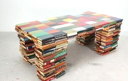 """designed by Richard Hutton and shown at Milan Design Weekand exhibited as part of a collection of seven pieces of furniture titled """"Layers."""" The table's legs are stacks of books and a top of books laid flat."""