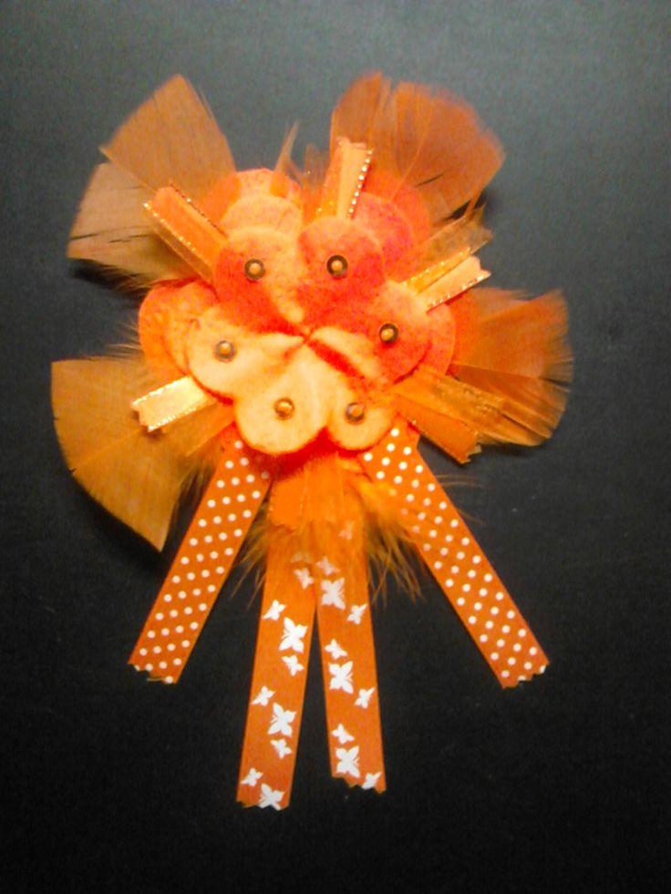 oranje corsage/rozet