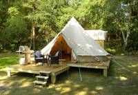 High-end glamping in a tree-fringed Dorset field, complete with kingsized beds, wood-burning stoves and private bathrooms.