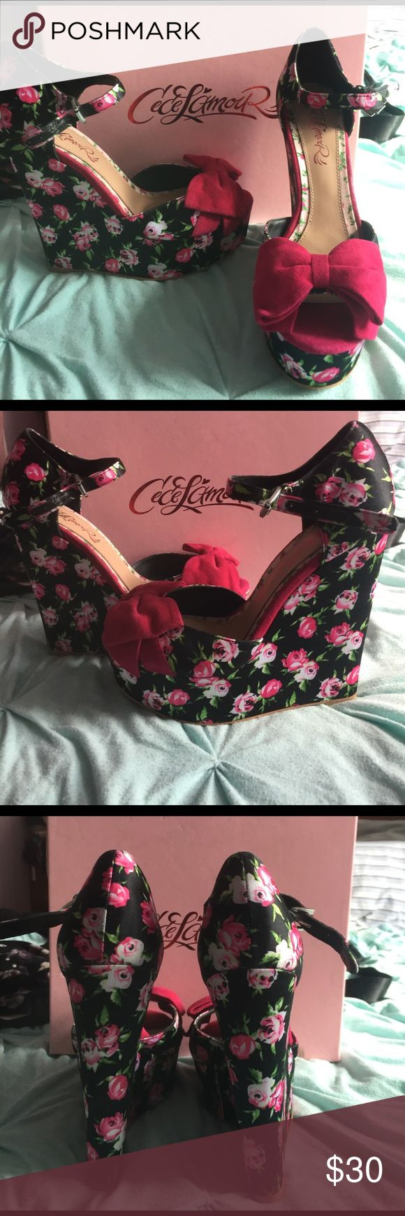 """Floral garden party hot pink bow wedges These wedges are 6"""" tall, but surprisingly comfy! Black with pink flowers on them with big pink bows on the front! Perfect for tea, spring parties or weddings! Only worn a few times. cece lamour Shoes Wedges"""