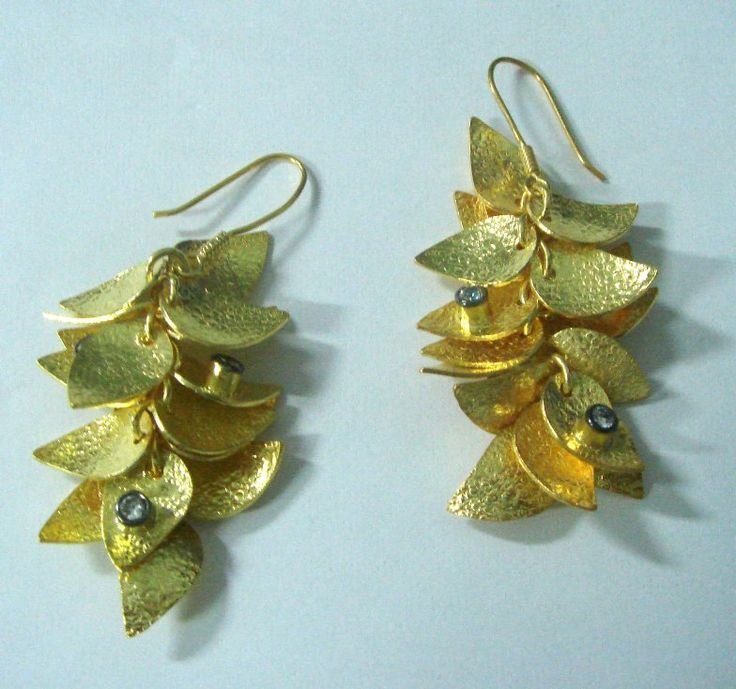 Chandelier earrings in Gold plated silver leaf clusters studded with semi precious stones (cubic zirconia or swarovski crystals).