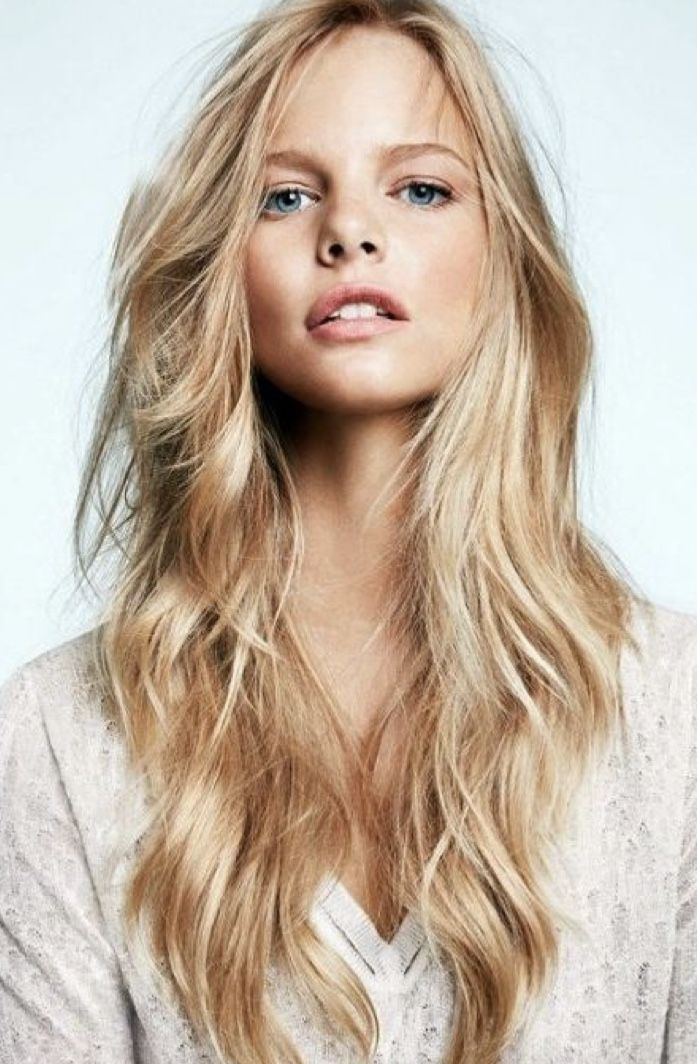 Teen girl with long blonde hair looking to the side by dina marie giangregorio