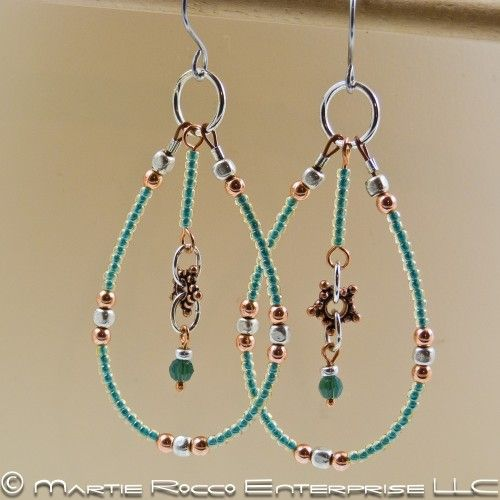 Large hoop earrings with green glass seed beads and copper.