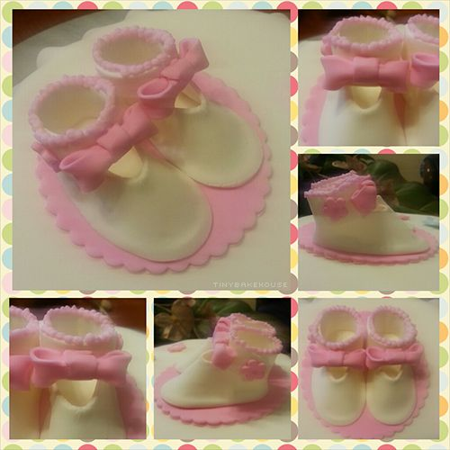 Booties - White booties made from fondant with pink decorations such as the bow and flower.