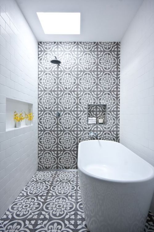 Like these Moroccan tiles and also like the wet room / skylight idea