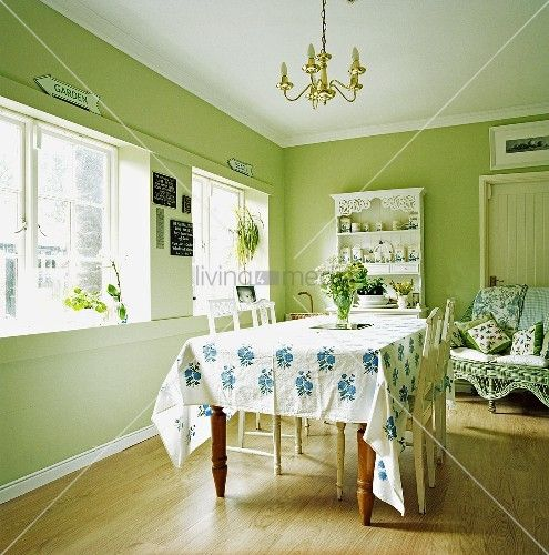 living4media - the bright and sunny breakfast room is painted in farrow & ball's cooking apple green