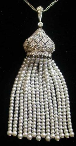 Edwardian platinum and diamond necklace with pearl tassel. Some of the premier jewelers in the world were at their peak when platinum jewelry really took off in the late 19th – early 20th Centuries. The strength of platinum meant that very intricate designs could be created which were lacy and refined, were also very durable. A preference for white platinum over yellow gold was also cemented by the sinking of the Titanic in 1912, which sparked a trend for black and white mourning jewelry.