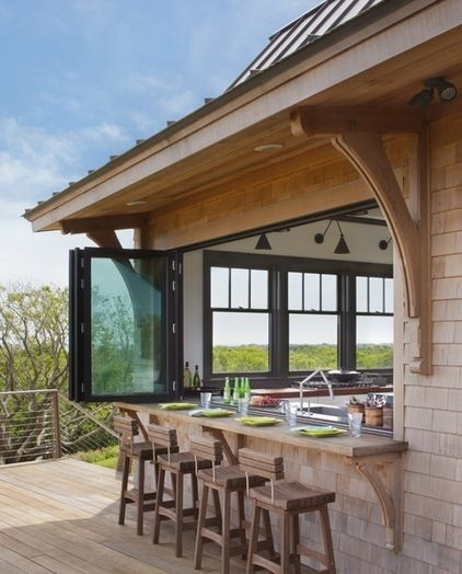 This is great!  A kitchen window that opens to your deck for a counter/serving bar.  (contemporary patio by Eck | MacNeely Architects inc.)