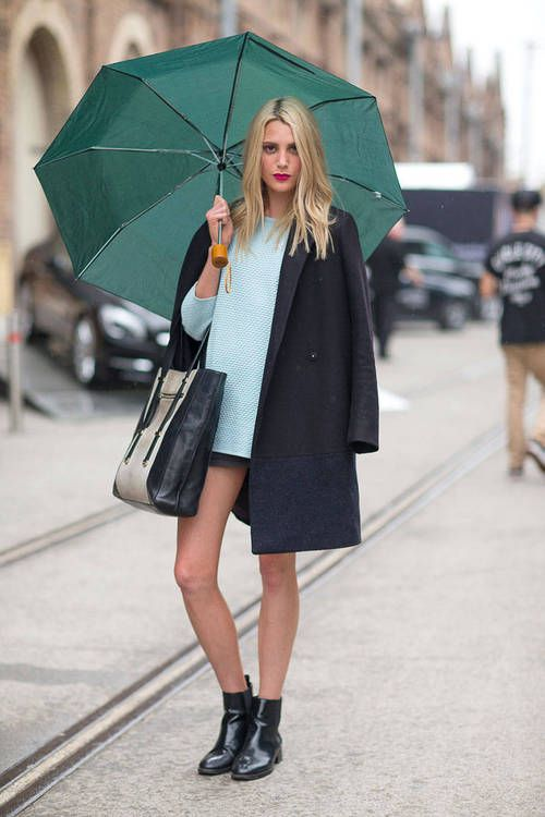 Shop this look on Lookastic:  http://lookastic.com/women/looks/black-tote-bag-black-chelsea-boots-light-blue-crew-neck-sweater-black-coat/2502  — Black Leather Tote Bag  — Black Leather Chelsea Boots  — Light Blue Crew-neck Sweater  — Black Coat