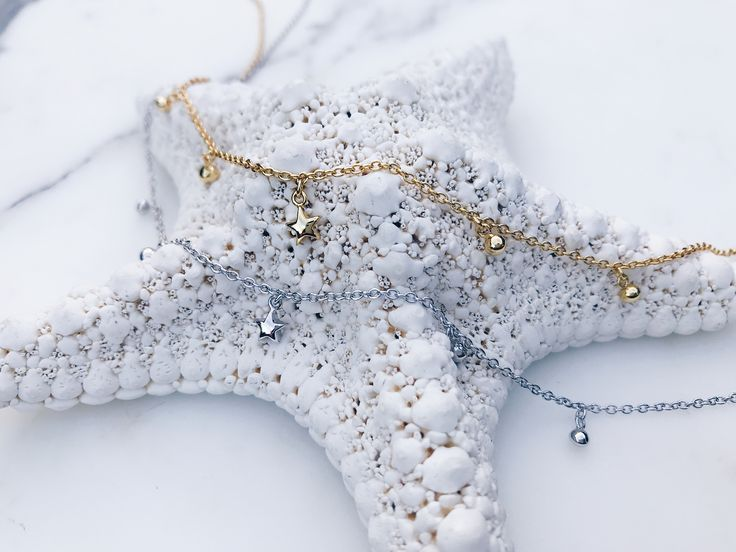 SHOP our little star necklaces, so perfect for layering. Gold and silver pair brilliantly together for a modern mix. Click to shop