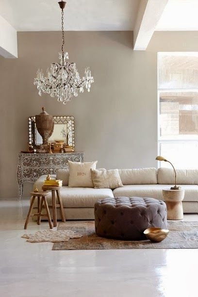 the chandelier adds drama to this natural palette yet cool space w/ good light streaming in