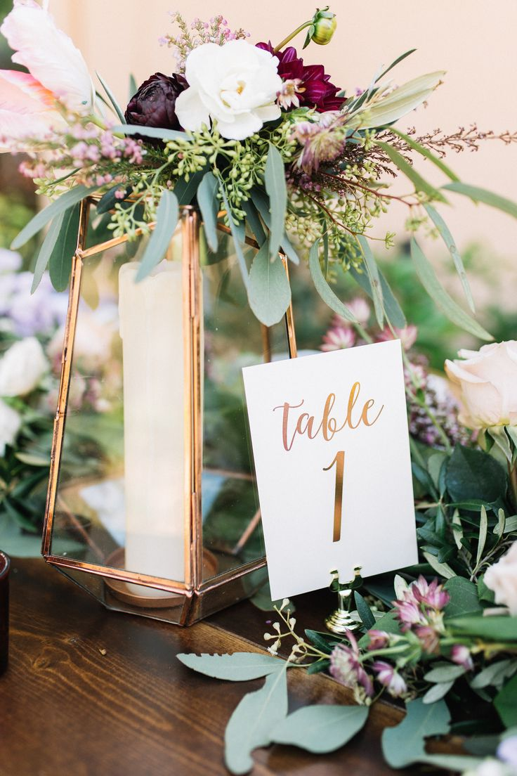 copper himmeli lantern for the reception table is dressed with a cluster of burgundy dahlia, light pink parrot tulip, ivory spray roses, heather, olive & seeded eucalyptus.