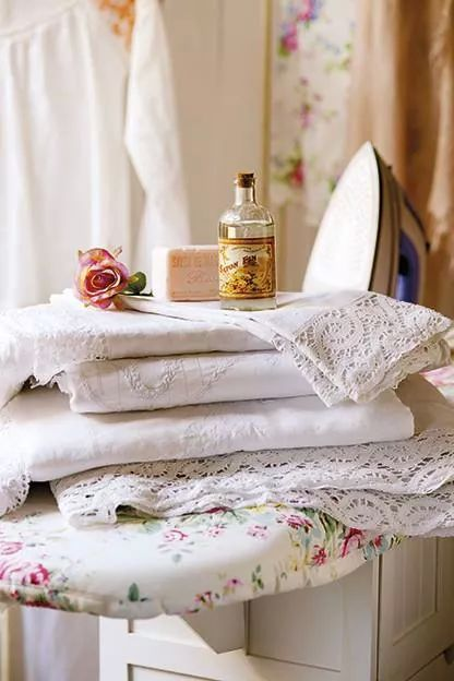 Simple & elegant/floral ironing board cover, perfumed linens, if you have to do laundry you may as well enjoy it and make it pretty