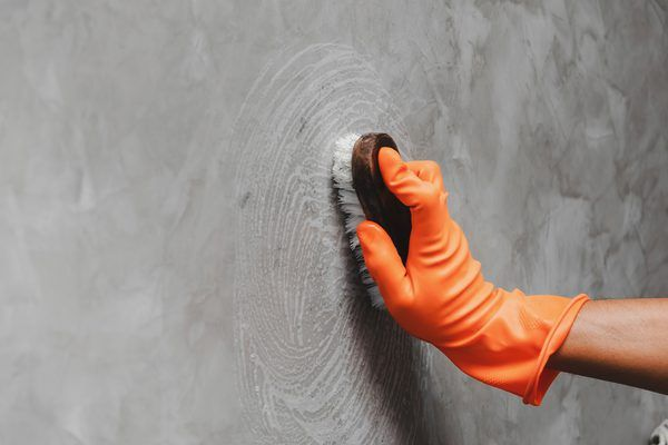 clean the surface to fix a cracked wall