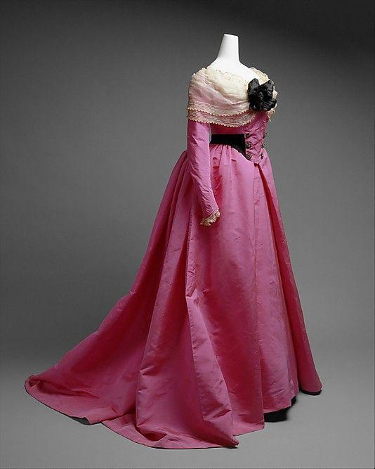 House of Worth, Bright Pink Silk Dress with White Fichu & Black Flower. Paris, ca 1900.