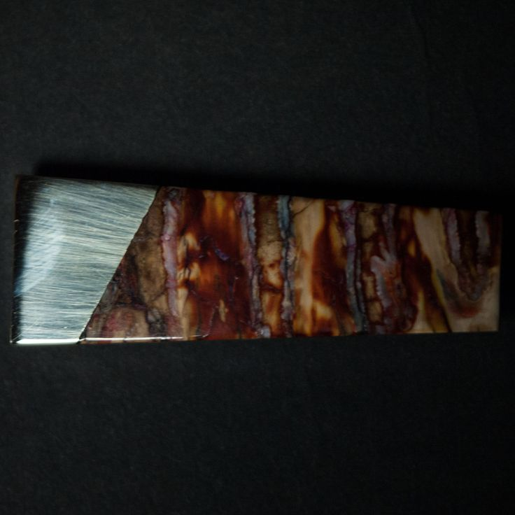 WOOLLY MAMMOTH TOOTH MONEY CLIP RED