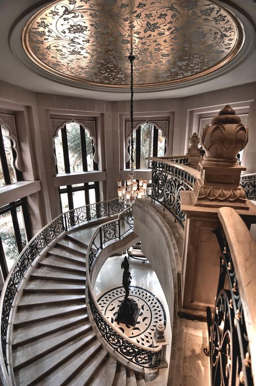 ~ ceiling bling over an amazing STAIRCASE.  A medallion design on the marble FLOOR.