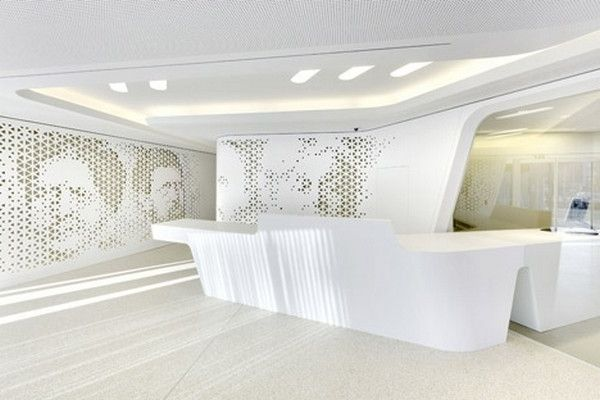 Another_angle_of_the_reception_desk_and_its_clean_curves-Modern Bank Interior Design - Raiffeisen in Zurich
