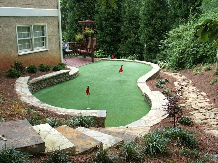 Backyard Putting Green Designs this custom green is wrapped with a lush tropical garden protected by sprawling trees Outdoor Putting Green Backyard Designsbackyard