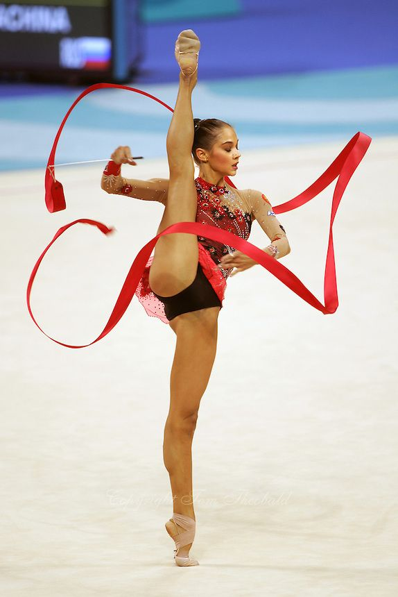 Irina Tchachina of Russia turns pirouette with ribbon at 2004 Athens Olympic Games during qualifying round. Irina won silver in the All-Around final. #rhythmic_gymnastics