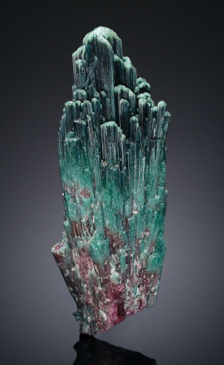 This 16-inch (40 cm) tourmaline goes up for auction June 2, 2013 with a starting bid of $30,000. Tourmalines are boron silicate minerals that get their rainbow-like colors from various elements such as iron, sodium or magnesium. This specimen comes from Brazil.