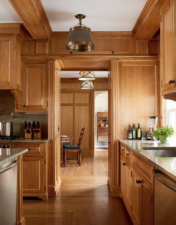With butternut walls, white oak floors, and pendants of the same shape and size, the kitchen and breakfast room have a seamless flow. The brass Sloane Street Shop Lights in the kitchen, and the butler's pantry, shown at left, are from Circa Lighting; the brass-and-silk Menton lights in the breakfast room are by Vaughan. The countertop and backsplash are Typhoon Green granite (shown in the next slide).   - HouseBeautiful.com