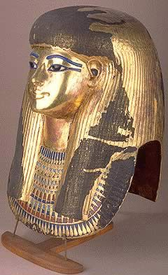 Thuya, Mother of Queen - Glass, Semi-precious stones, Period:          New Kingdom, 18th - DynastyReign:   Amenhotep III - Height: 40 cm Width: 28 cm - Thuya's mask, as all other funerary masks, was considered an indispensable element for the protection of the deceased's head and its parts are identified with the principle deities of Egypt. It is made of gilded plaster and was sealed within a series of wooden coffins. It was found broken, but in 1