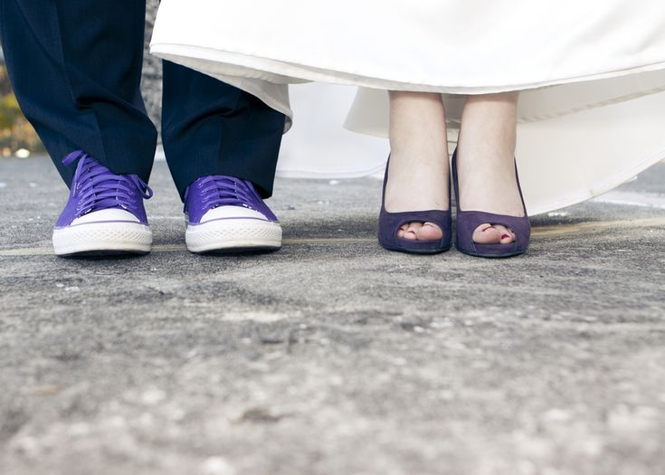 I know this is a popular idea for photos, I just like that they're both wearing purple shoes!
