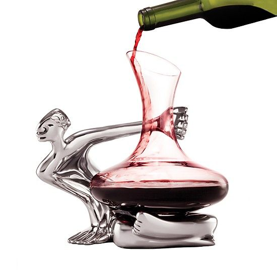 Impress your dinner time guests by busting out this absolutely charming wine decanter!  Bring out the rich flavors of your favorite wines with this striking decanter set from Carrol Boyes. It features a shapely glass decanter that rests artfully on a sculptural aluminum stand, lending dramatic presentation to dinners and gatherings.