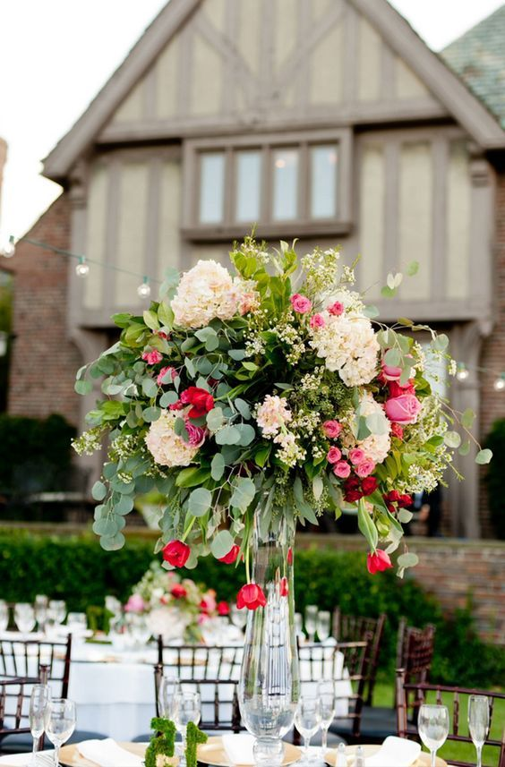 Elegant garden party table decor ideas Cascading centerpieces with roses and greenery / http://www.himisspuff.com/tall-wedding-centerpieces/5/