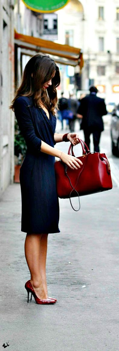 Stay fashionable and professional this fall with a simple wrap dress. We love the red accents added by the lips, shoes, and bag!