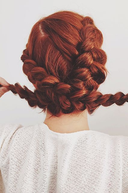 You can also simply pull and place the braids for an updo moment, which is especially easy when you've started with a pigtail situation. Here, I'm just pulling them opposite from each other before securing in place.