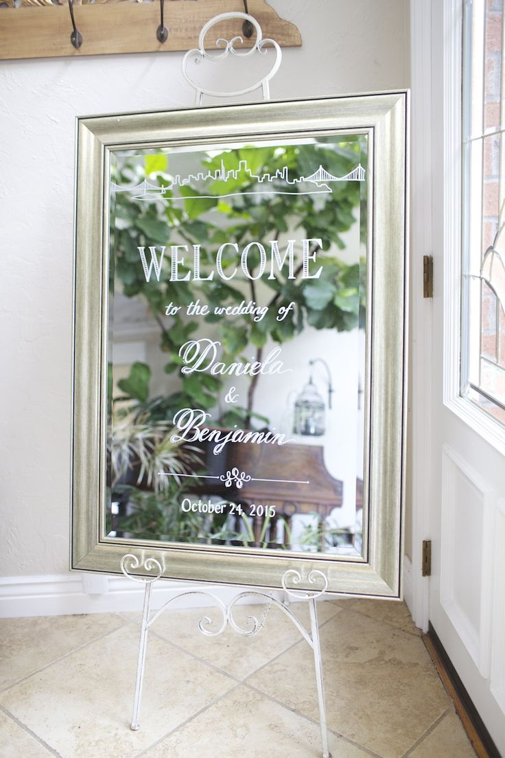 Beautiful Wedding Welcome Sign. Custom painted silver framed mirror with San Francisco skyline and bridge detail. City wedding in style.