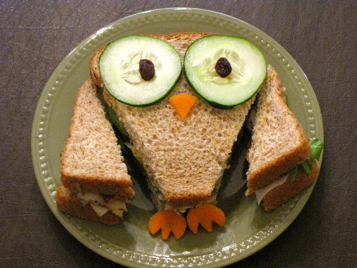 Make sandwich with any filling your kids enjoy.  Slice cucumber and place two slices on top of bread.  Top each cucumber with one raisin.  Slice carrots.  Cut one slice into a triangle for the nose.  Cut two notches in two slices of carrot for the feet.  And viola!  You have an adorable owl sandwich!
