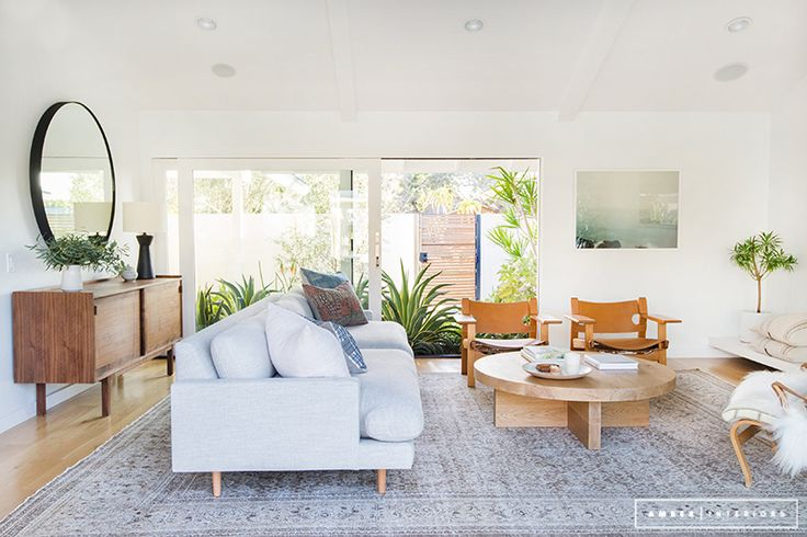 Minimalist Mid-Century living room with large glass windows