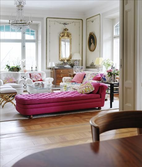 I'd love to have this living room, with comfy yet elegant sofas in bold fuchsia and Josef Frank patterns