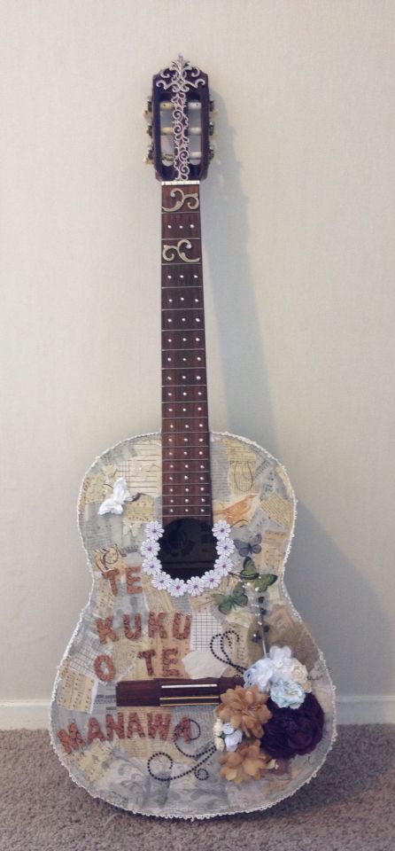 Guitar done up with music sheets and flowers... Loved doing this  gifted with love