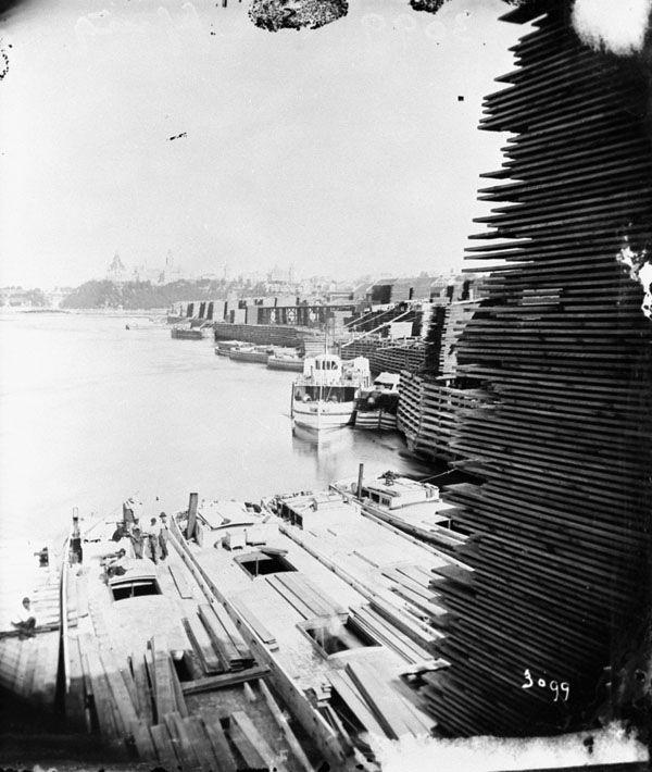 J.R. Booth's.  1873.  Loading Lumber (600×710)