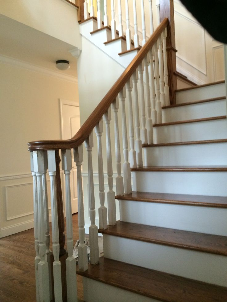 Mixed White And Brown Wooden Staircase Leading To The Second Floor Of House