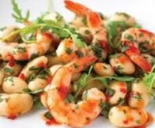 Coriander and sweet chilli prawns    1 kg green prawns, shelled and deveined   1 clove garlic   1 small bunch coriander   1 handful mint leaves   120 grams Teriyaki Sauce   60 grams Sweet chilli sauce   juice of a lime   30 grams softened butter
