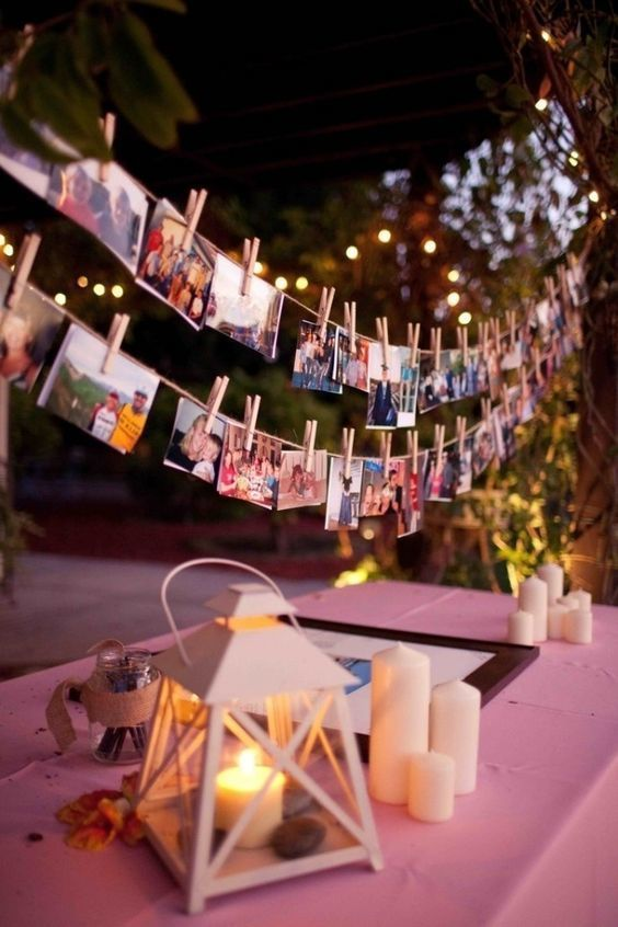 Sharing moments from your love story could make a great conversation starter among your guests! Take your old childhood photos and snaps of your favorite memories together to print for an easy and unique DIY centerpiece. You could hang them above candlelit table centerpieces as seen here and even use them to personalize your welcome table.