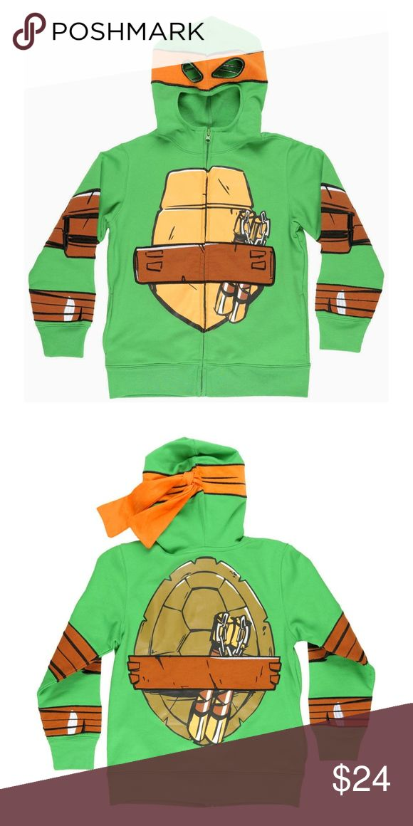 NEW! TMNT MICHELANGELO MASK HOODIE! MEDIUM! 7/8 TMNT MICHAELANGELO MASK HOODIE!  Brand New With Tags  Size: Boys Medium 8/10  Details: -Nice young boys character hoodie. -Bright green cotton blend material. -Embroidered Michaelangelo TMNT graphics throughout. -Holes in hood to see through. -Full length zipper down front. -2 hand pockets. -Shoulder to hem measures approx. 23 inches. -Chest measures approx. 17.5 inches across. -Sleeve measures approx. 20.5 inches from shoulder.  ★ ALL ITEMS…