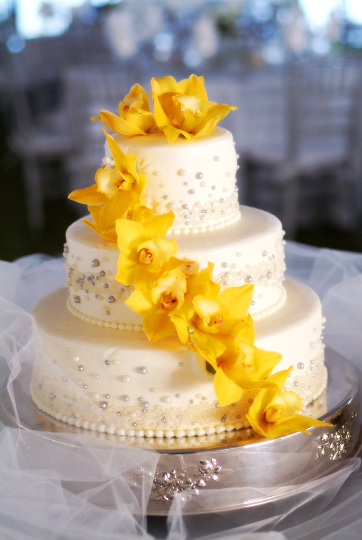 Weddings Cake. Flowerman Weddings. Cascading waterfall of large yellow cymbidium orchids