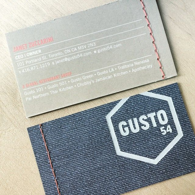 Business cards featuring white foil on denim textile, duplexed to Cougar Opaque Smooth 130#DTC. Cougar Printed CMYK featuring UV Waterless. +Red Stitching accent!