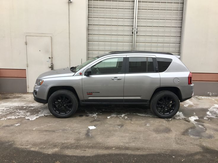 2015 Jeep Compass Altitude with Rocky Road Lift and 18 inch tires.