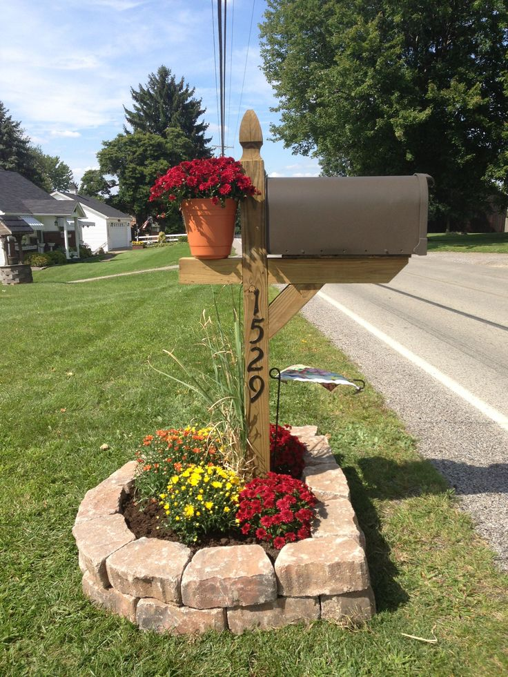Our mailbox recreated. It's no longer leaning and plain. Everything you see here can be purchased at Lowes. You can get a basic mailbox post or upgrade to the gothic style post for a $3 difference. (We chose the gothic style. What makes them different is the decorative notch between the flower pot and mailbox itself.) classic Mums for Fall.