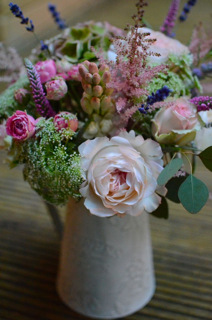 Rustic jug flower arrangement
